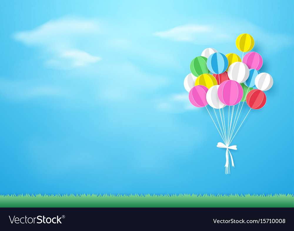 Colorful balloons flying over grass paper art and