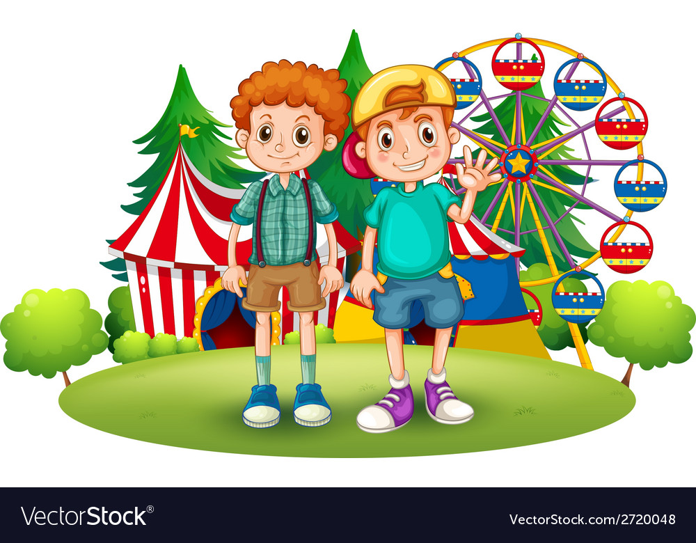 Two boys in front of the carnival