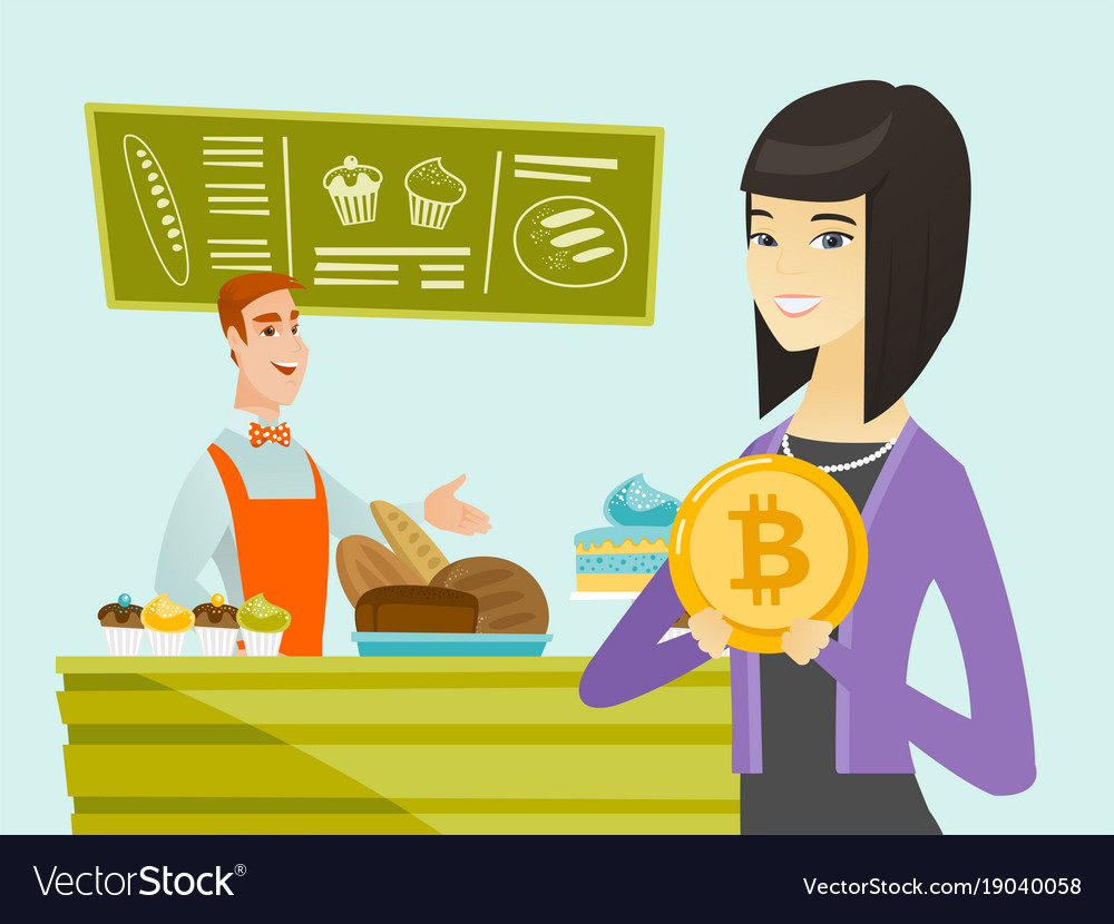 Young caucasian baker offering payment by bitcoin