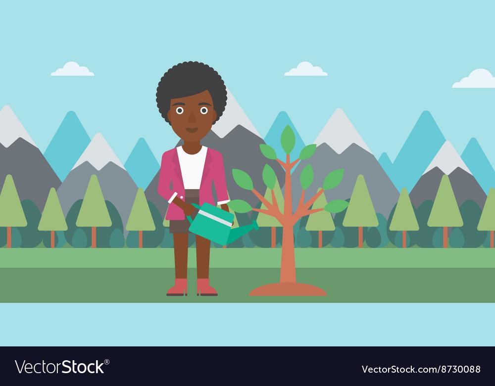 Woman watering tree with light bulbs