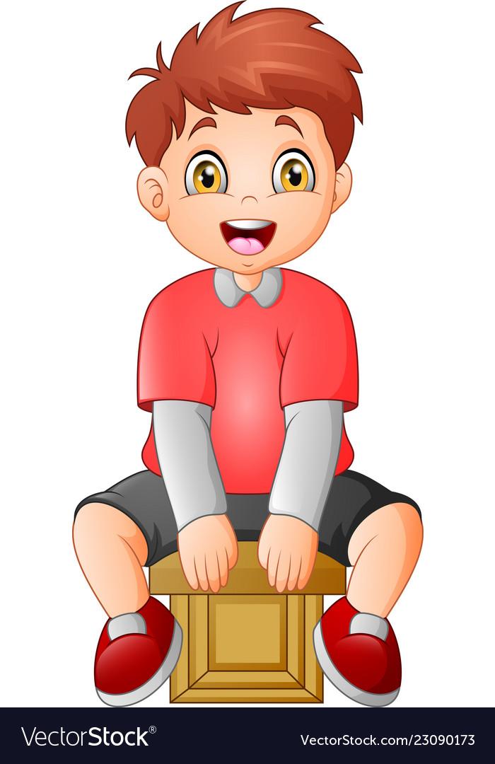 Cute little boy sitting on a cube