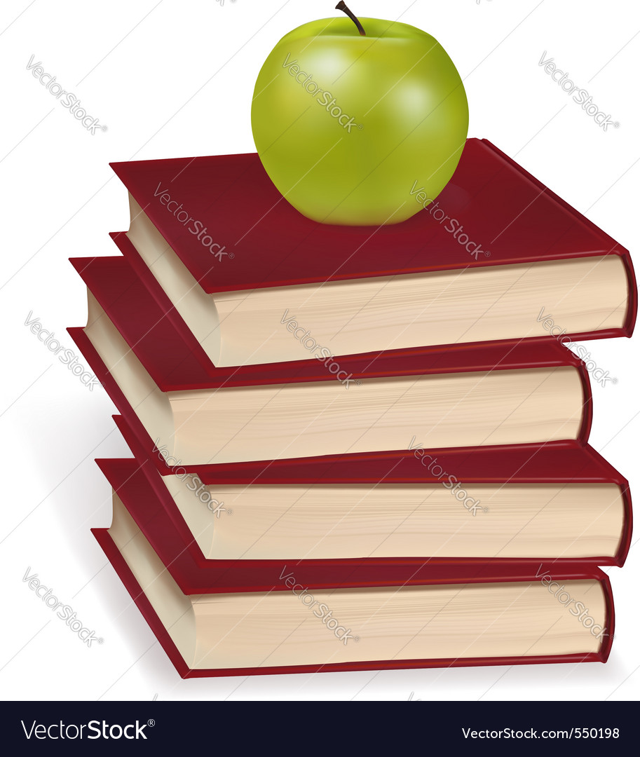 Green apple laying on the book