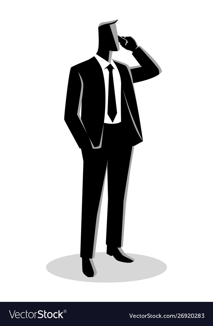 Businessman in formal suit standing while on phone