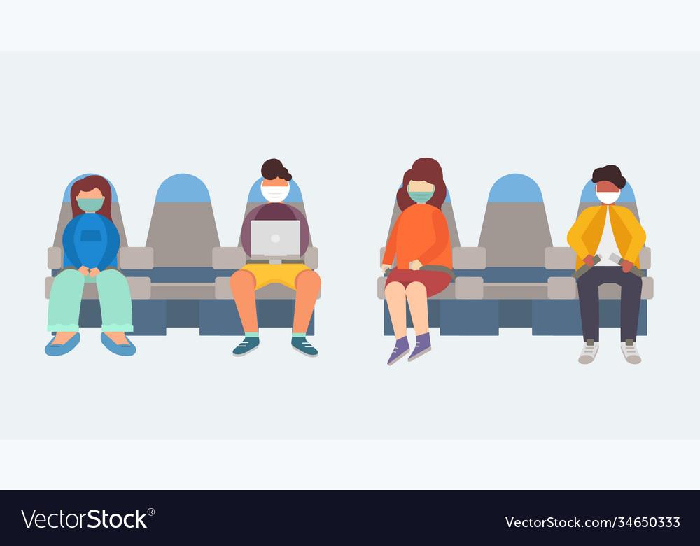 People in medical masks sit on plane