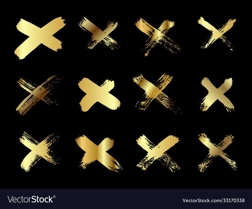 Hand drawn set cross brush strokes x gold
