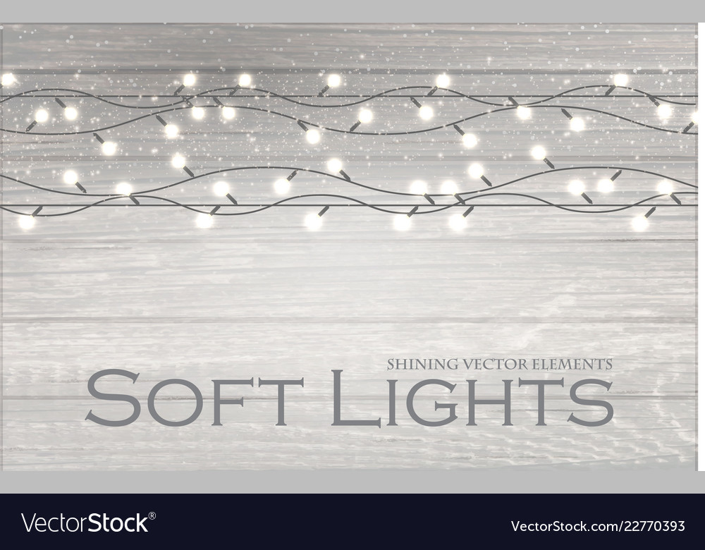 Christmas lights on wood texture soft winter