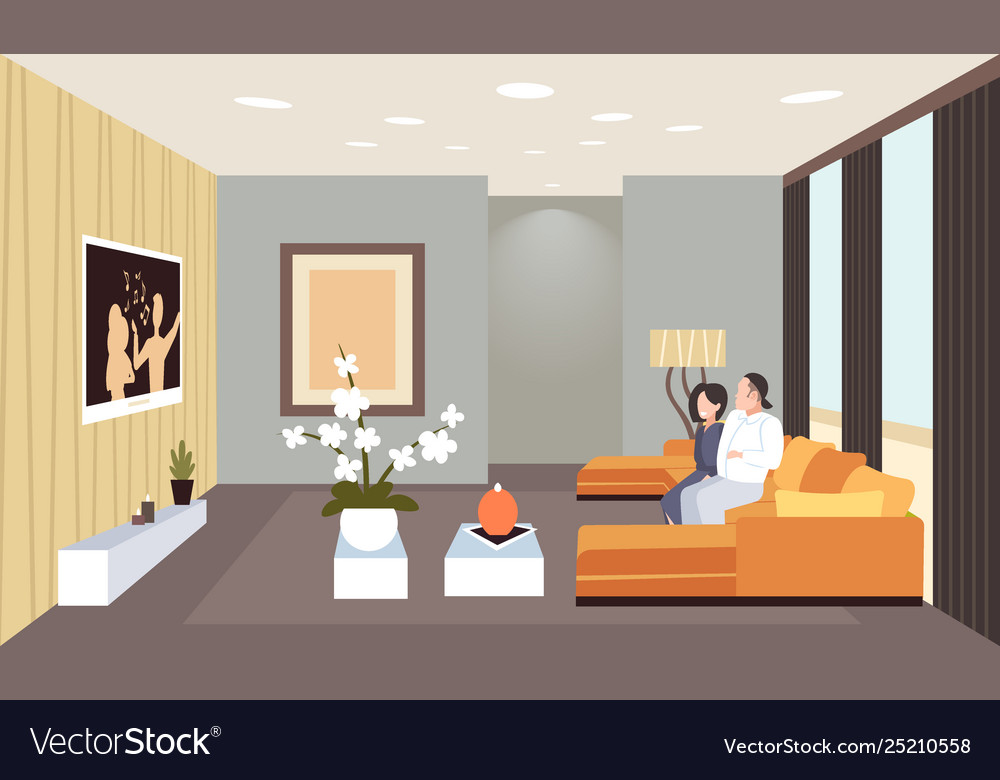 Couple sitting on couch watching tv man woman