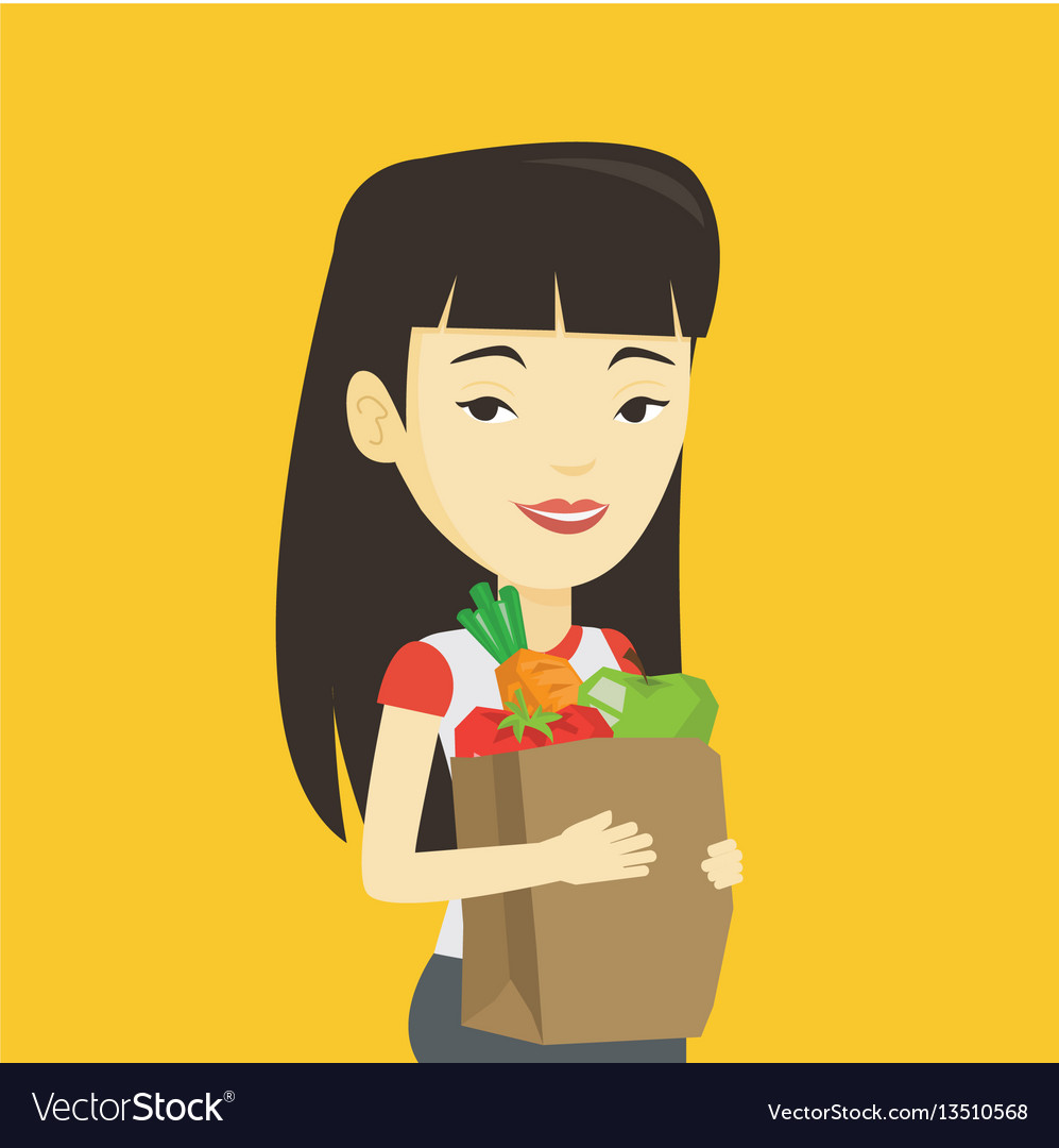 Happy woman holding grocery shopping bag