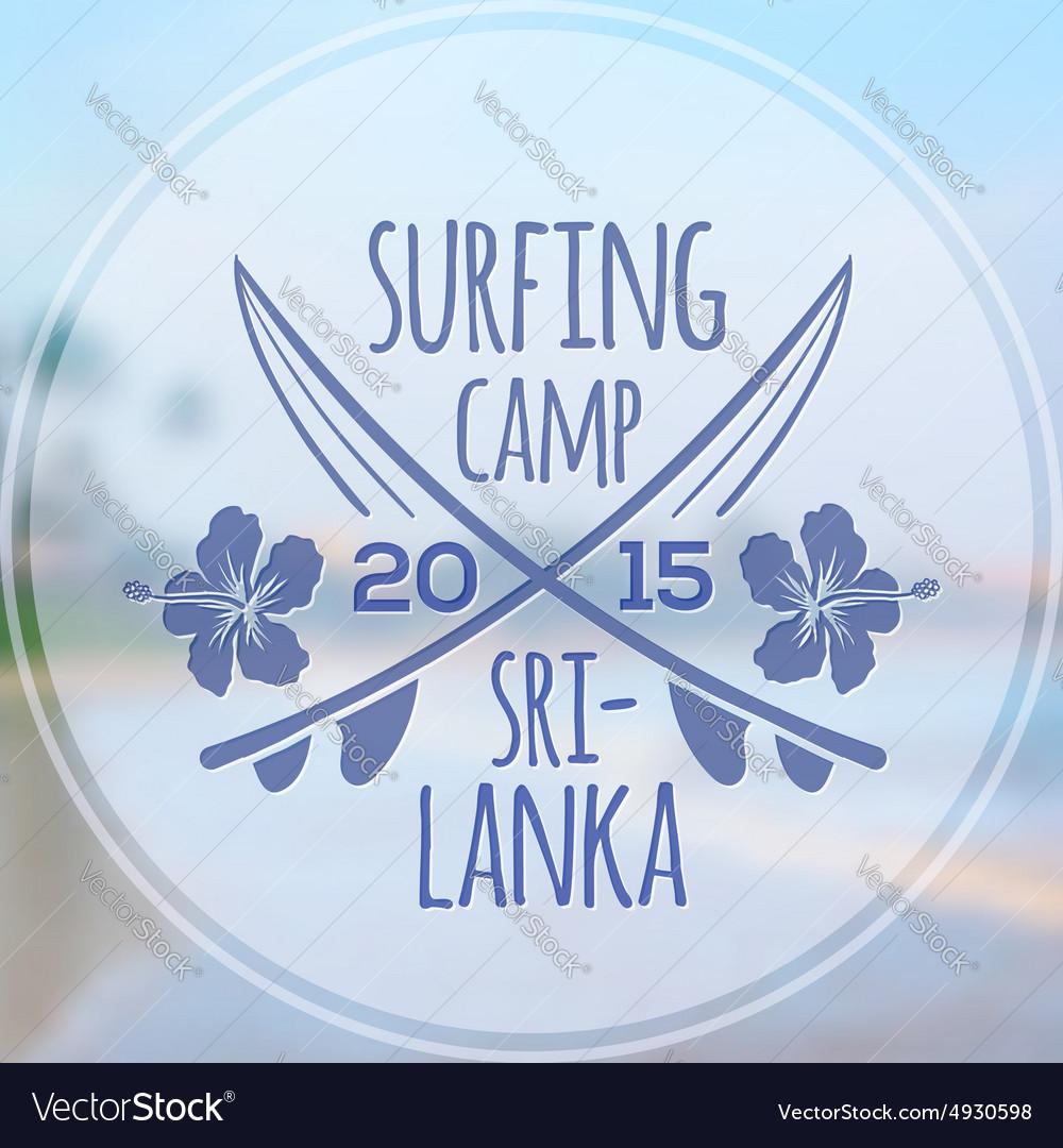 Surfing camp logo on blurred beach photo
