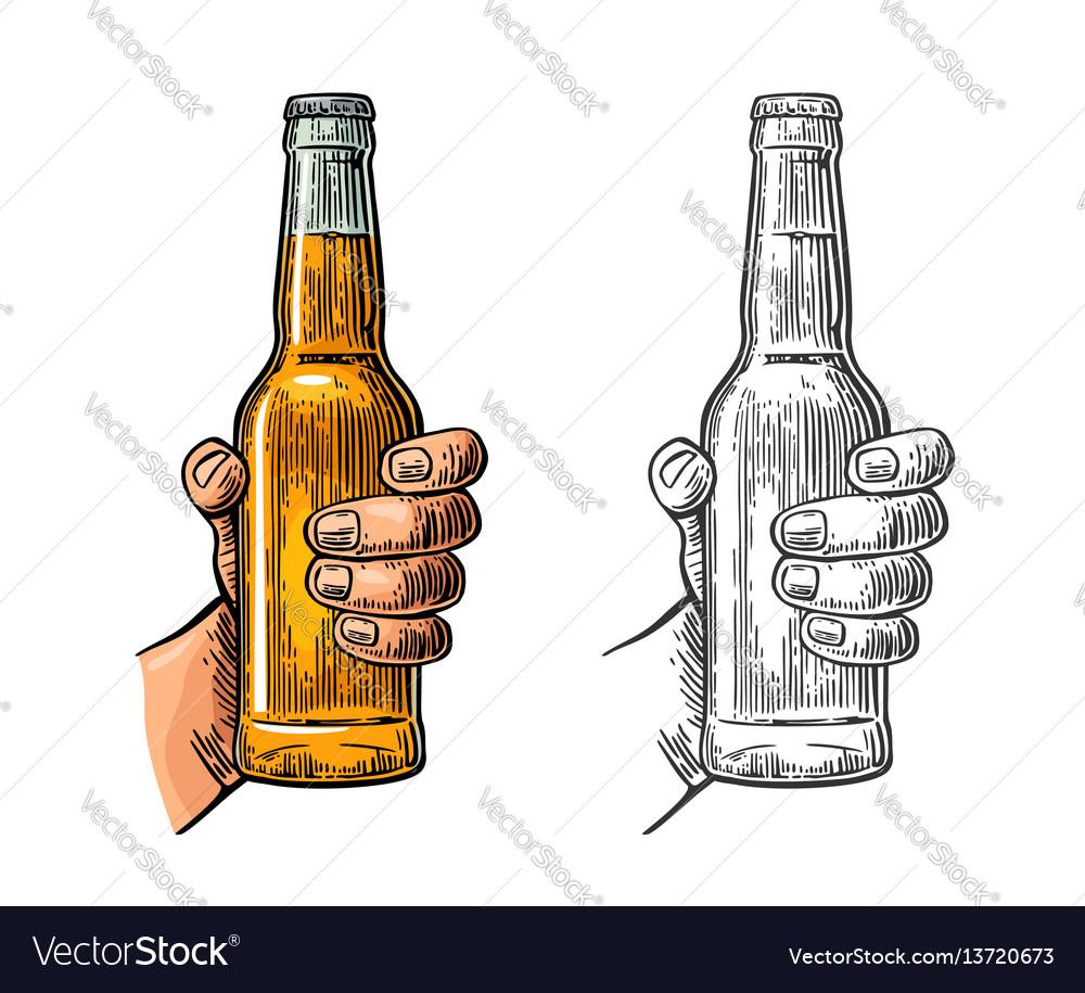 Male hand holding bottle beer color vintage
