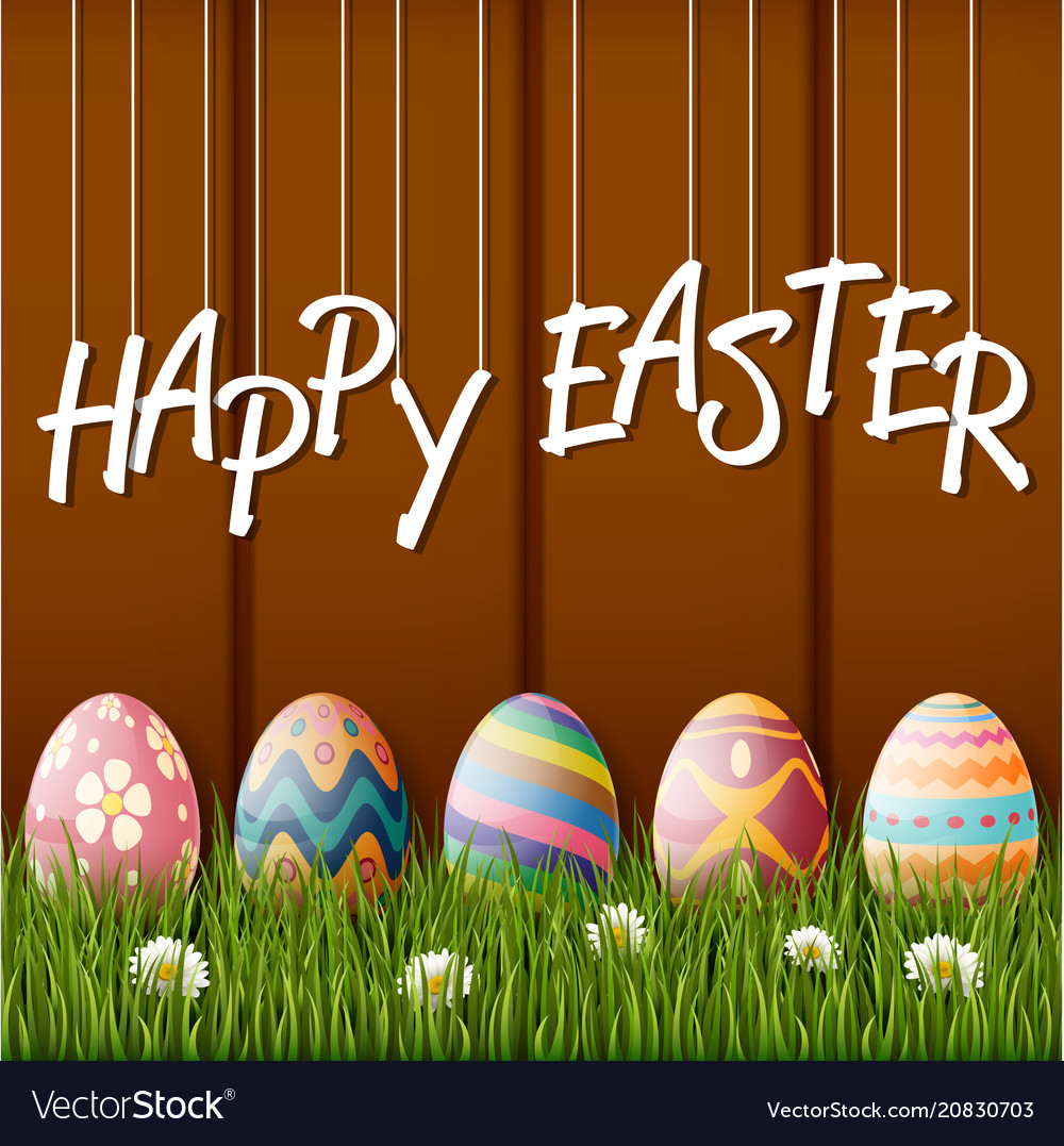 Happy easter with eggsgrass on wood background