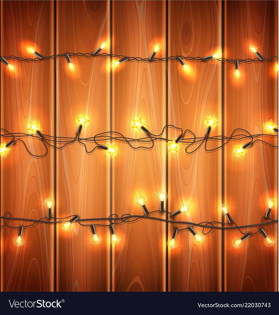 Christmas lights realistic garland on wood
