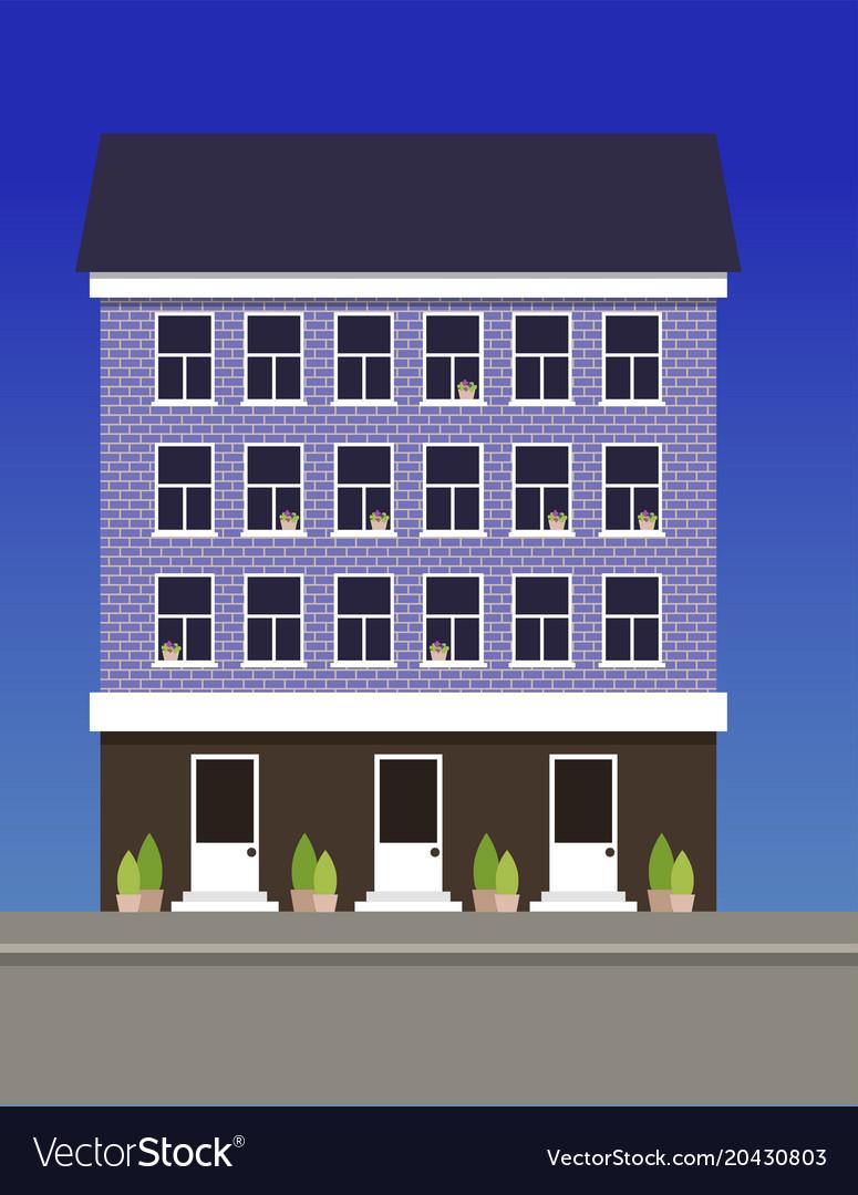 A multi-storey dwelling house made of blue bricks