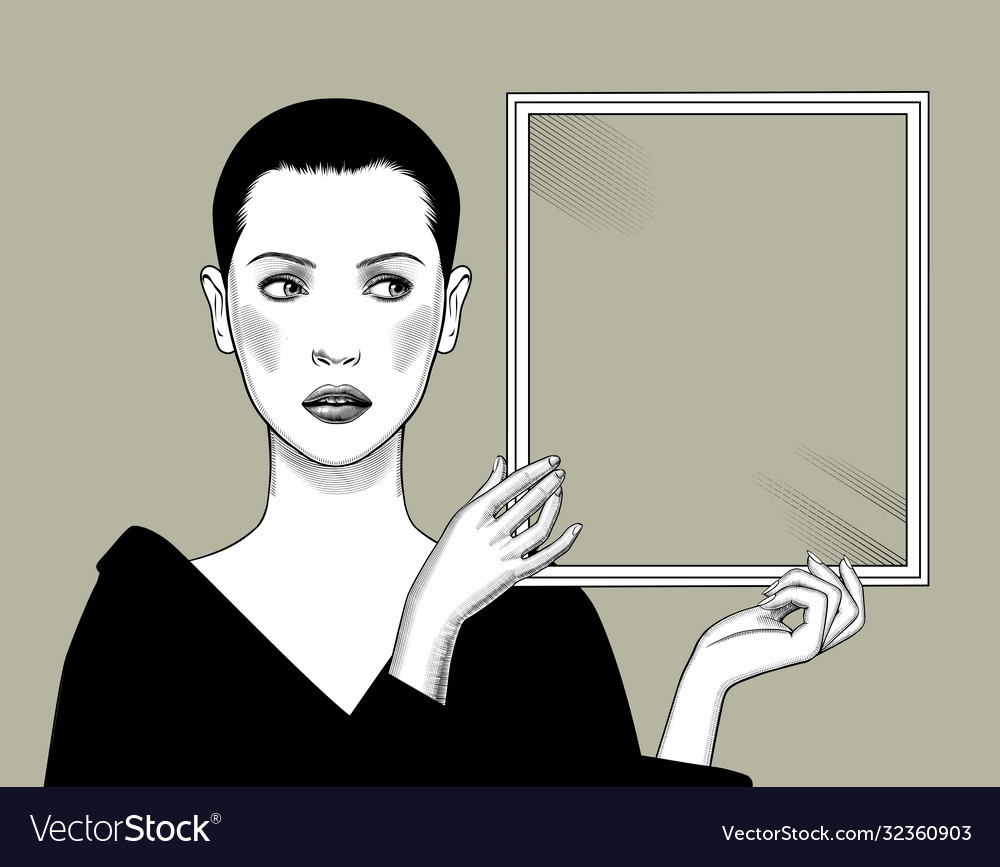 Woman with short hair holding a rectangular frame