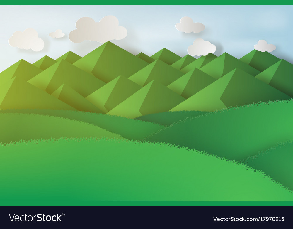 Paper art of green grass and mountains on a