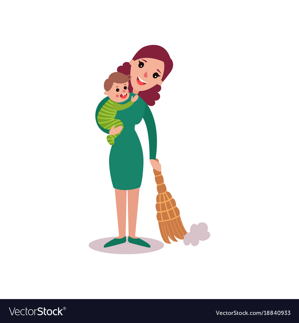 Mother sweeping the floor with baby in her arms