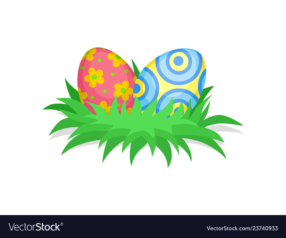 Two cute painted eggs in green grass happy easter