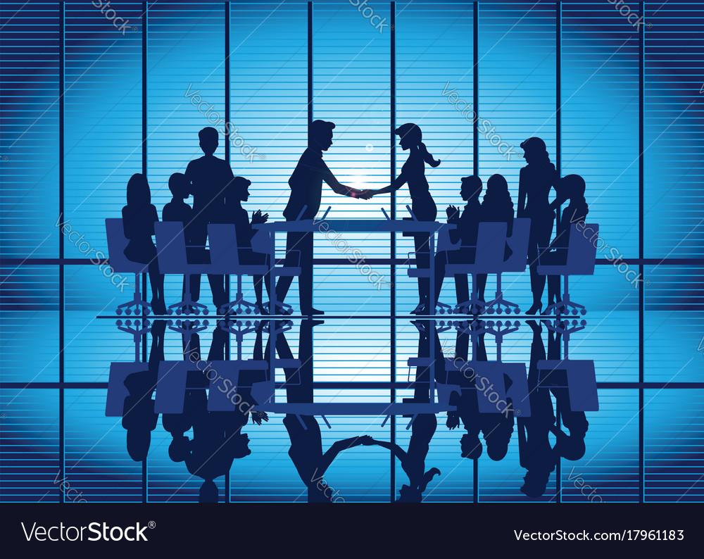 Silhouettes of business partnership handshake