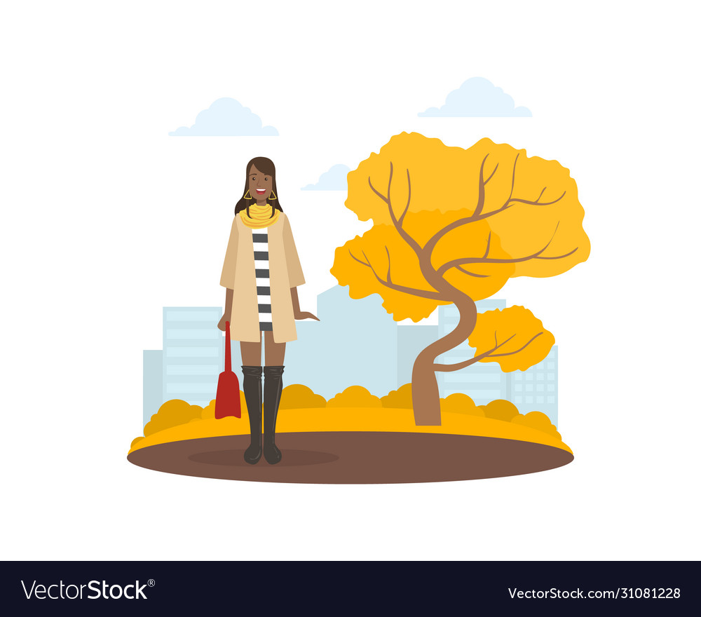 Young woman in fashion clothing walking in autumn
