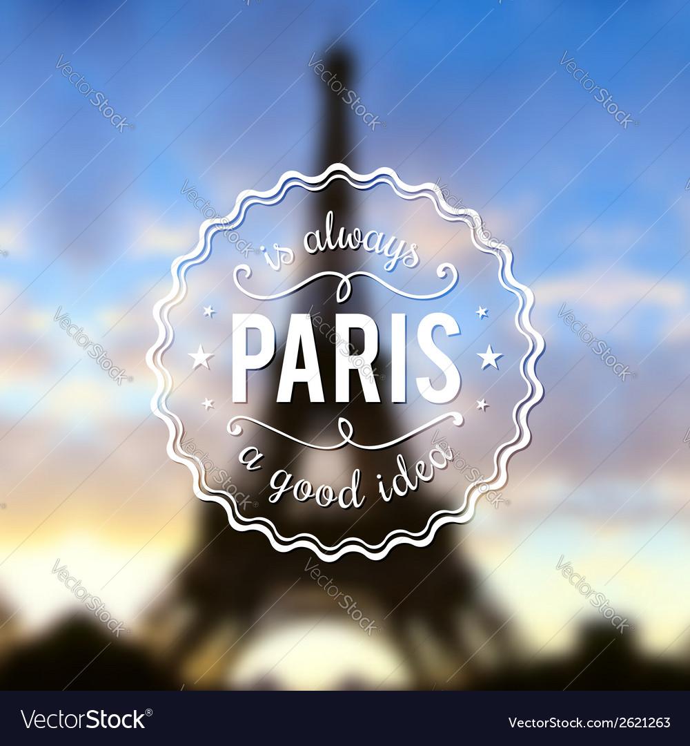 Paris typographic design on blurred eiffel tower