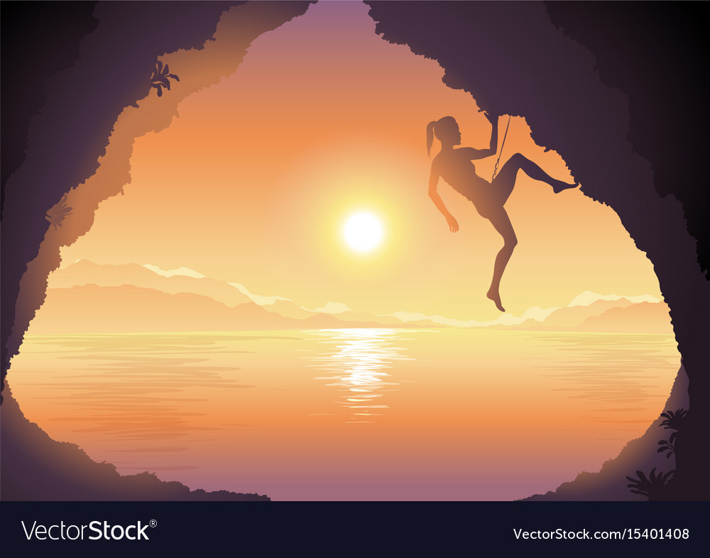 Woman climbing on a cliff beautiful sunset