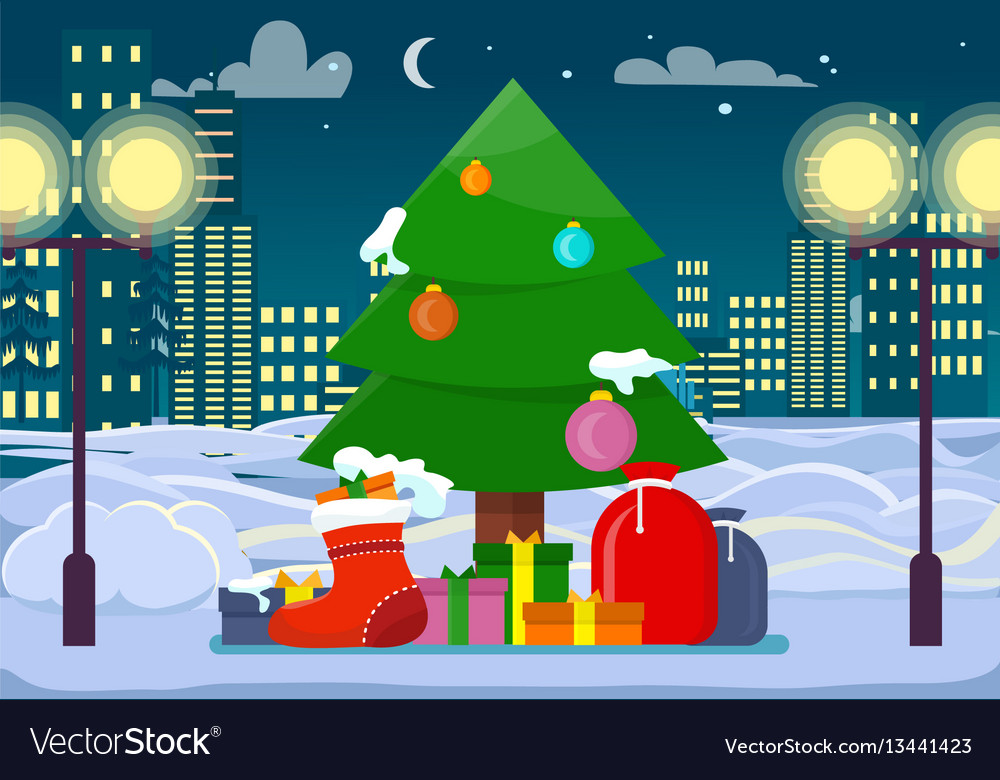 Decorated christmas tree with presents outdoors