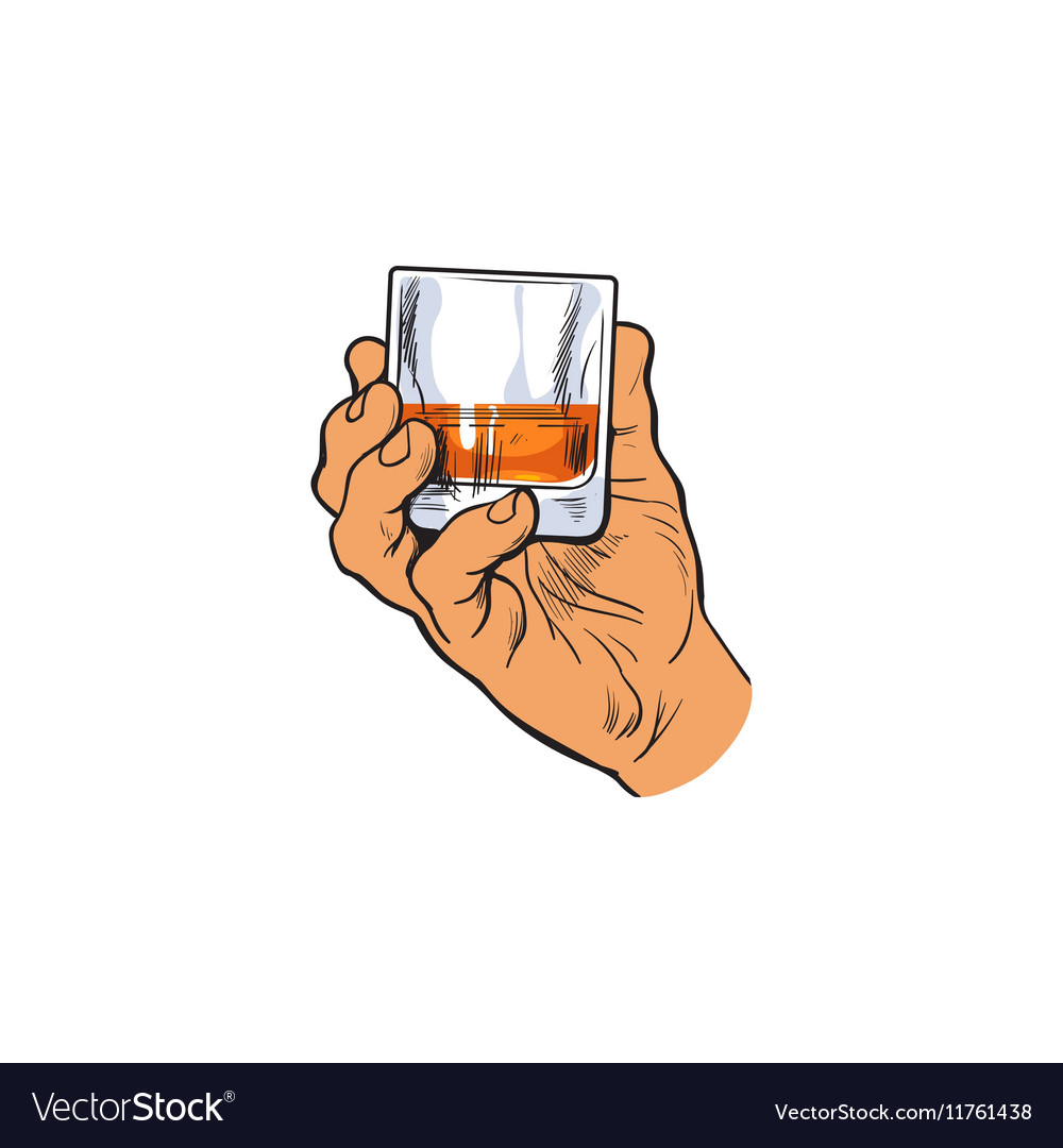Hand holding full glass of whiskey