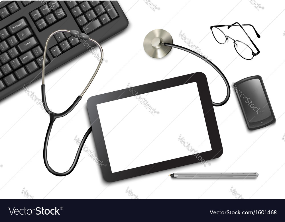 Tablet touch pad and office supplies on the table