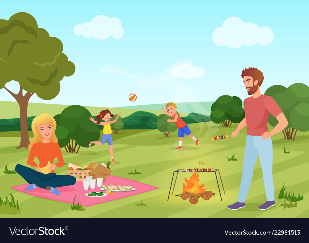 Happy youg family on a picnic in forest field