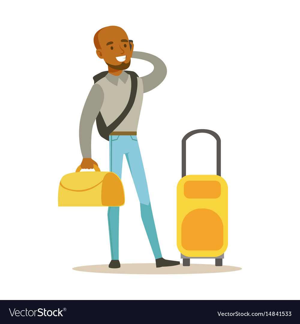 Young man standing with yellow suitcases and