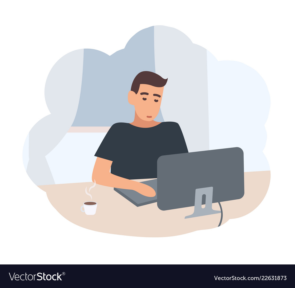 Young man sitting at desk and surfing internet on