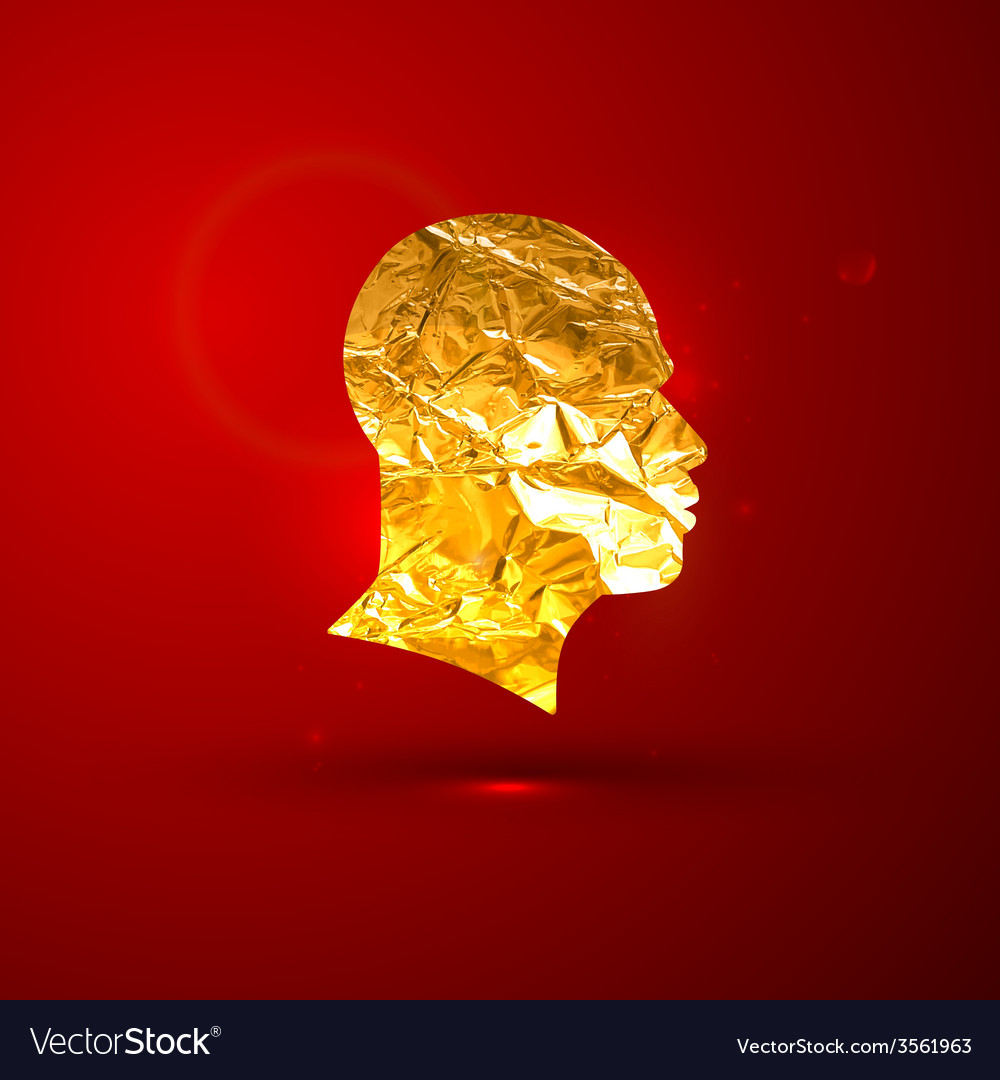 A golden foil human face on the red vivid
