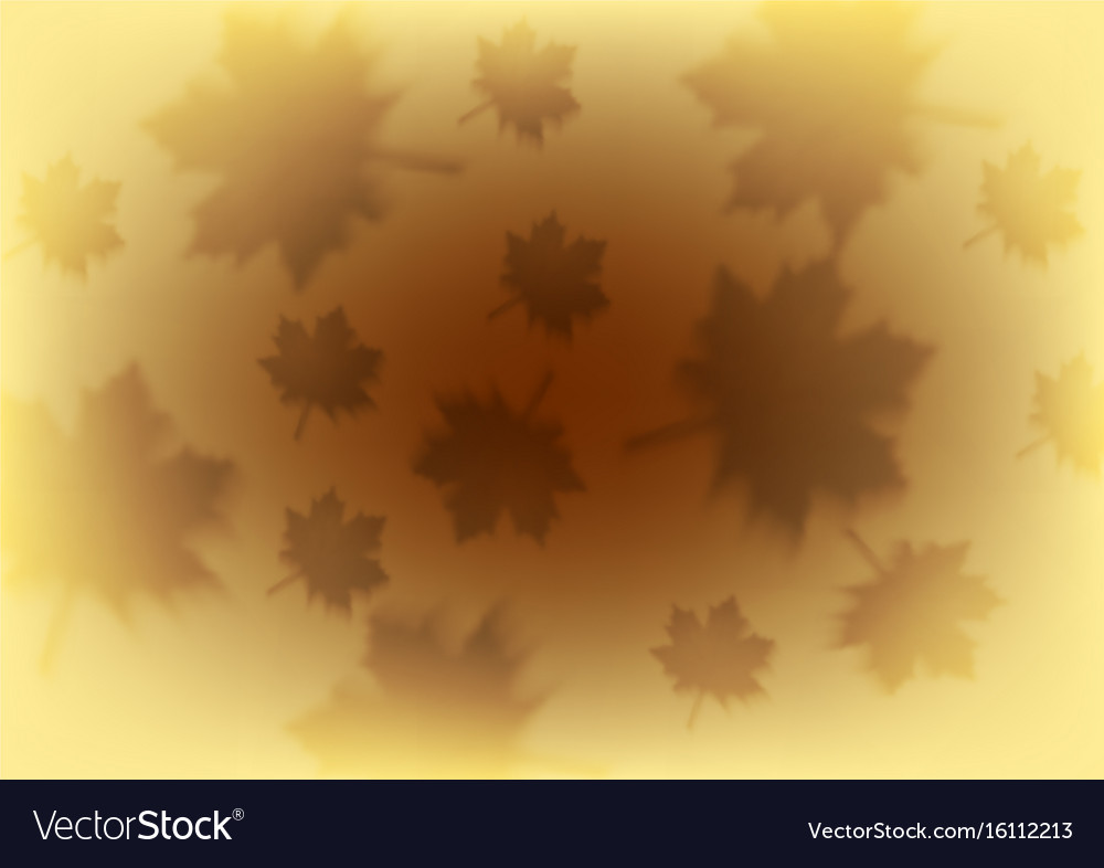 Orange autumn background with blurred maple leaves