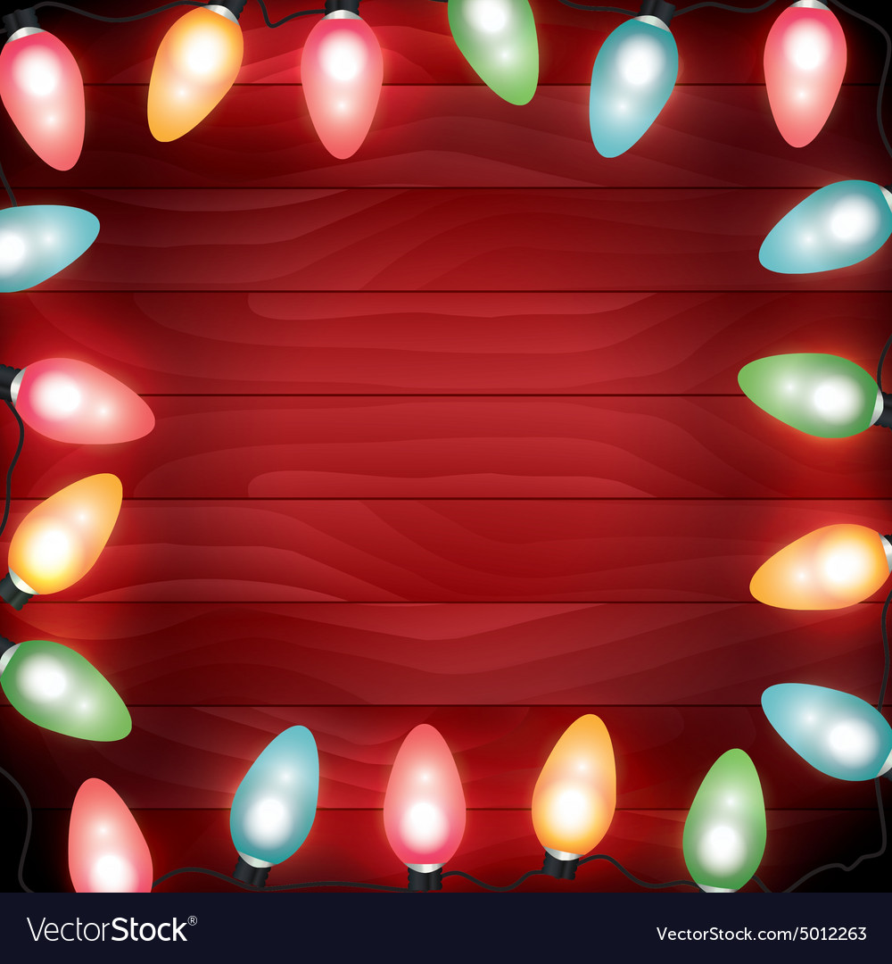 Christmas Lights Background.Christmas Lights Lit On A Red Wooden Background
