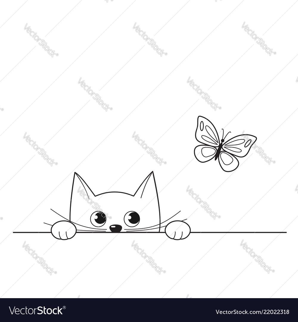 Cute peeking kitten watching a butterfly