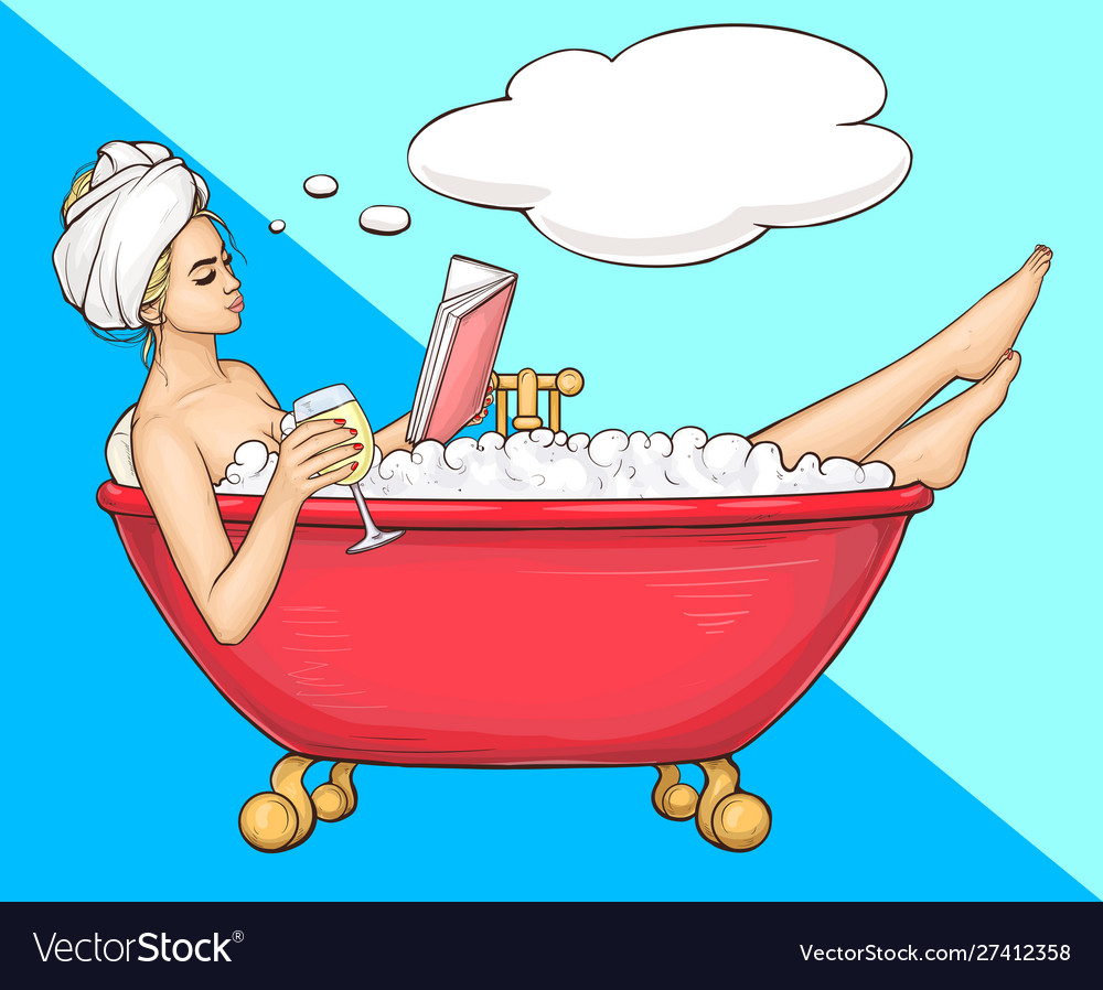 Woman having bath in bathtub with book and wine