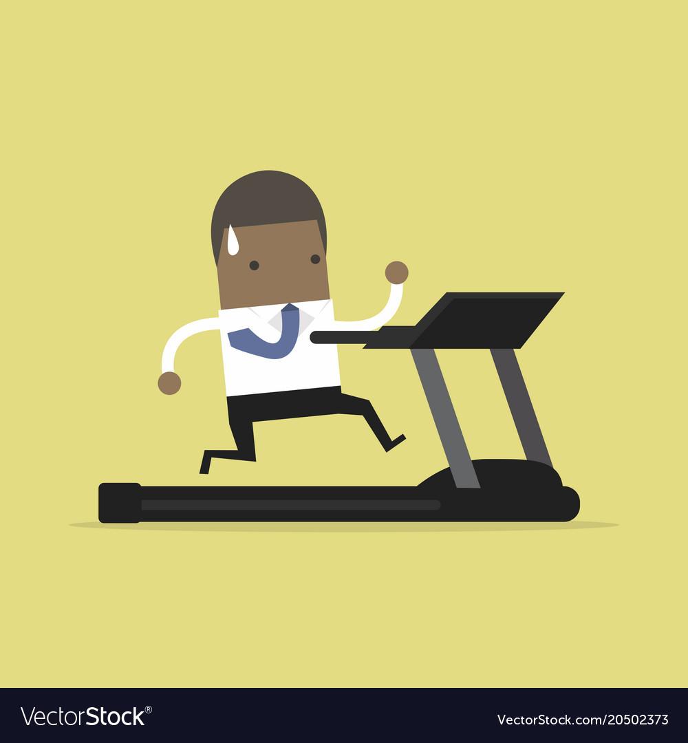 African businessman running on treadmill