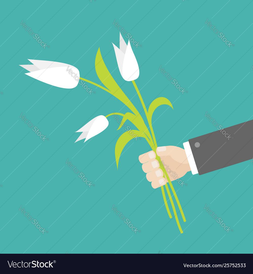 Businessman hand holding bouquet white tulip