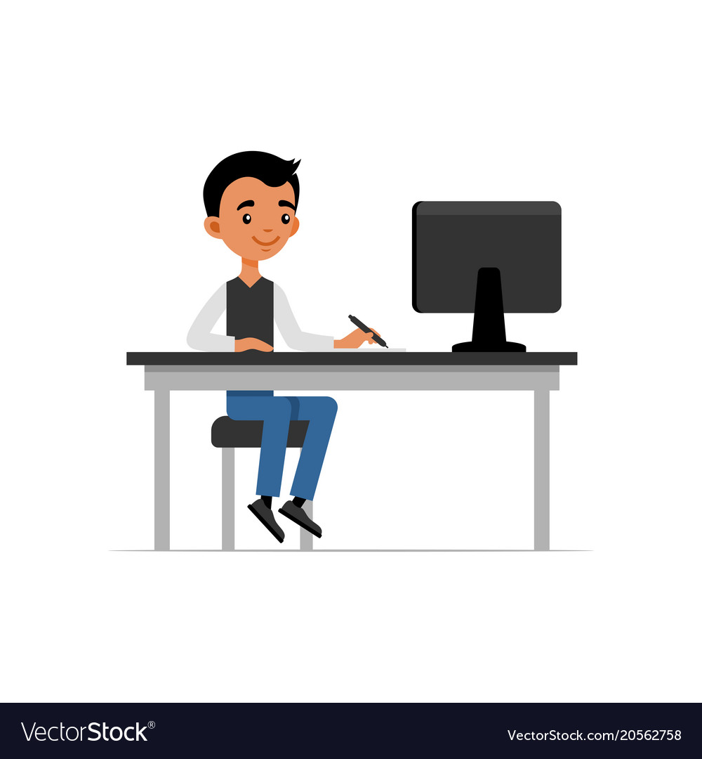 Cute young guy sitting at desk and working on