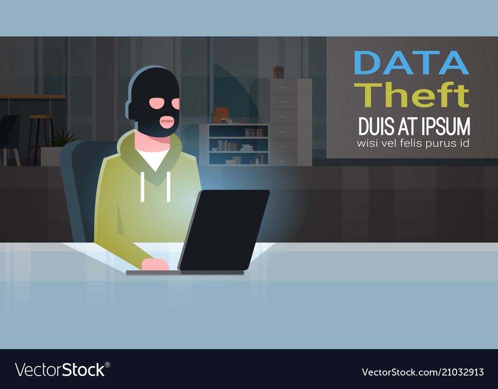 Man black mask sitting at computer hacker activity