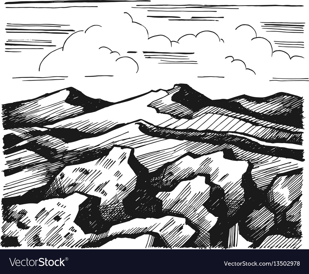 Mountains and rock against the sky with clouds