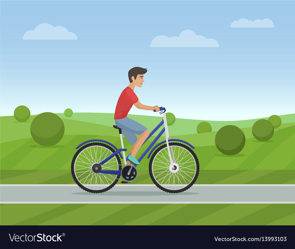Young man riding a sport bike on a park road