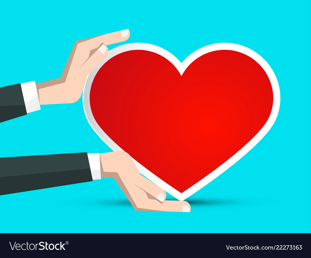 Red paper heart in human hands on blue background