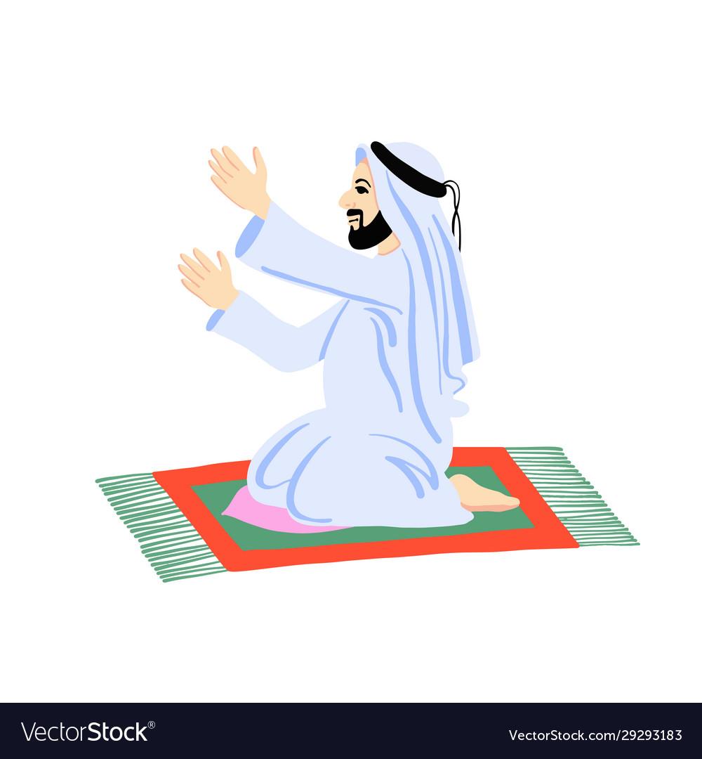 Arab muslim man praying on a praying carpet