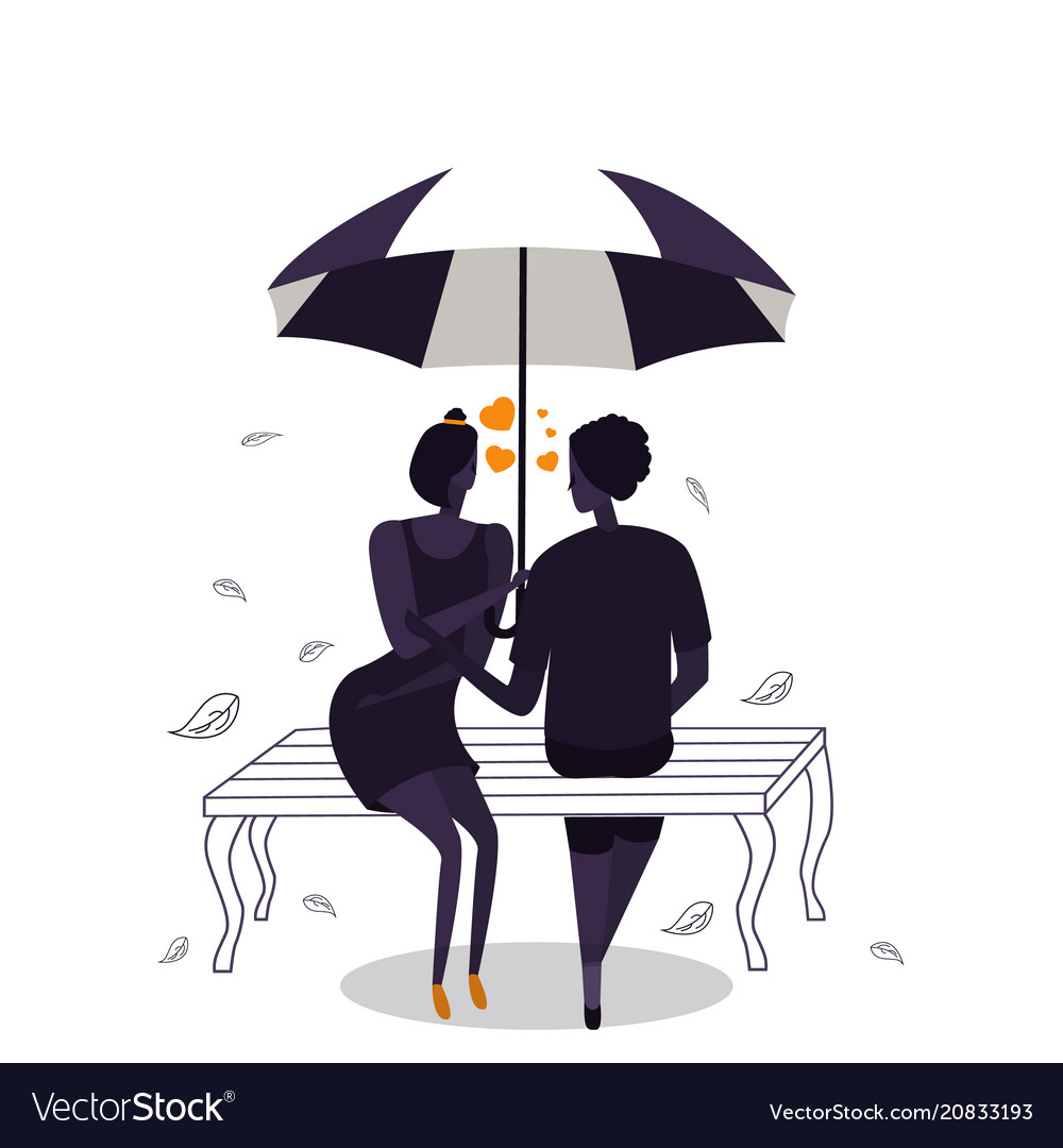 Silhouettes of couple under umbrella with heart