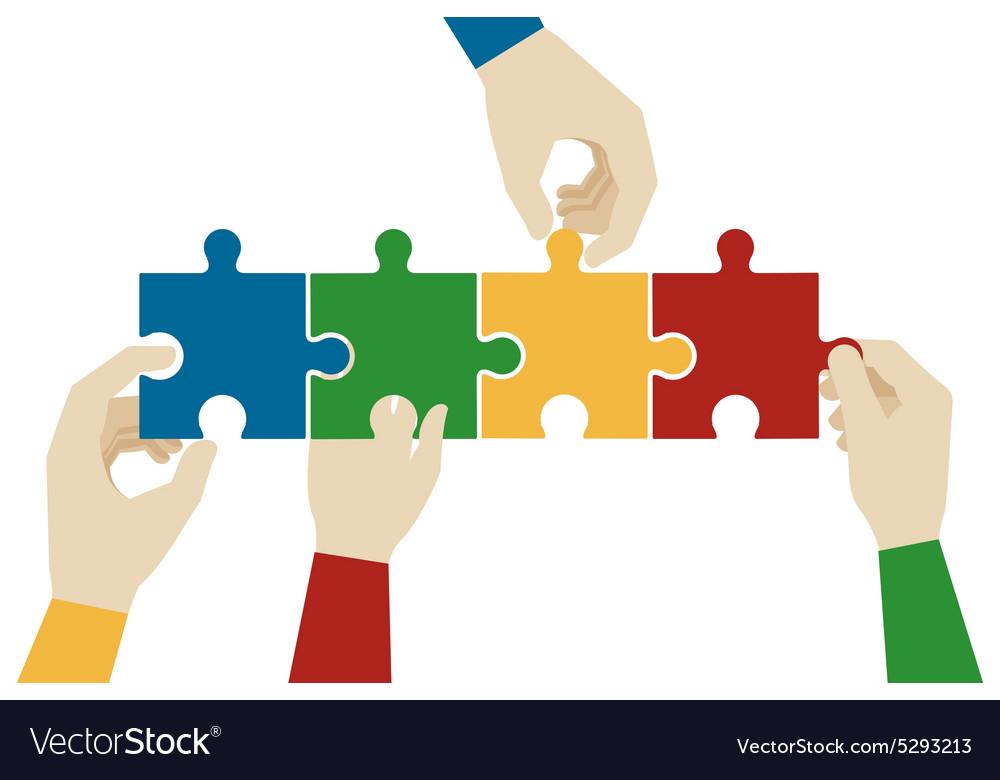 Hands assembling jigsaw puzzle pieces