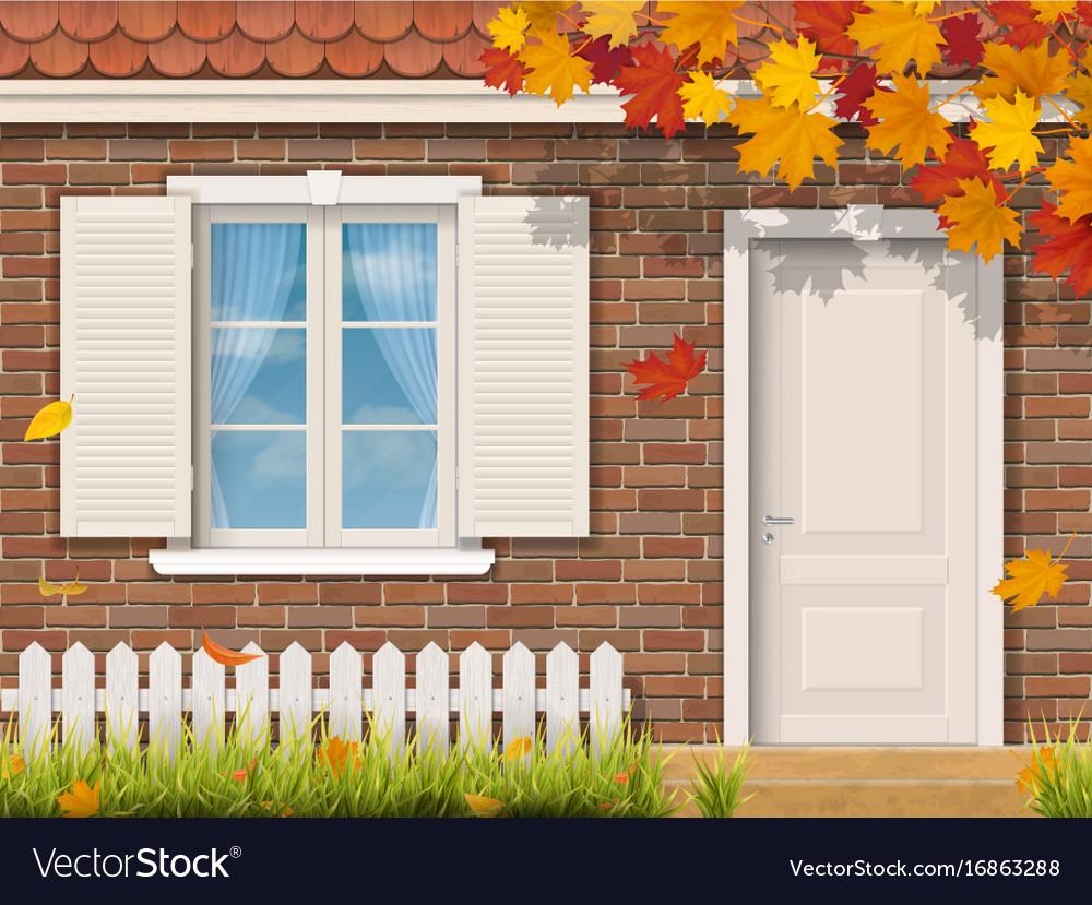 Brick house facade in autumn season