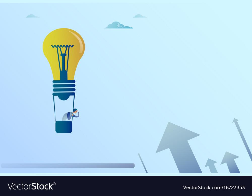 Business man flying on light bulb air balloon