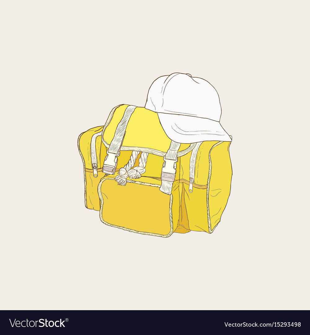 Yellow bag and white cap of camping backpack set
