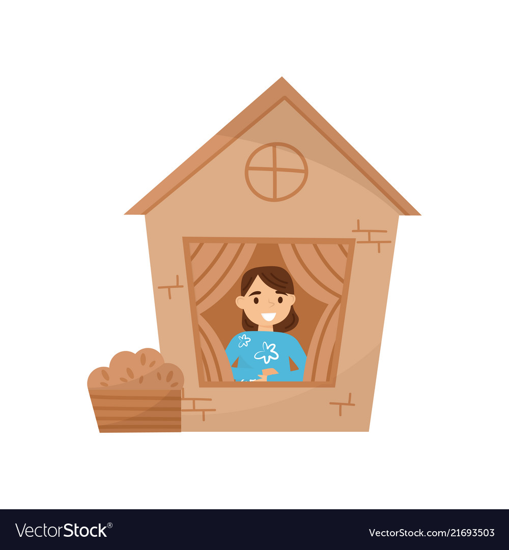 Cute little girl playing in house made of